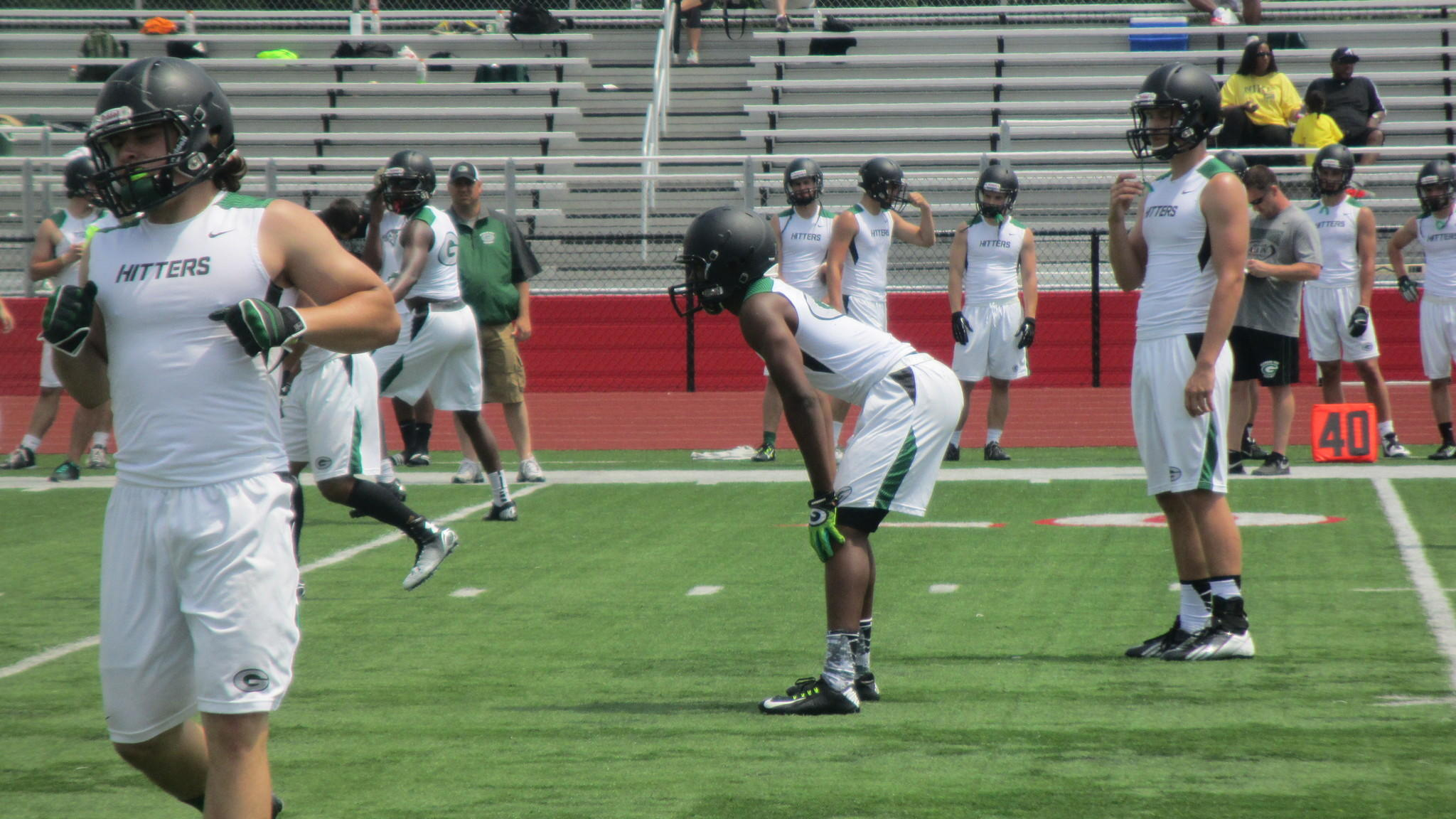 Glenbard West quarterback Kyle Kramer (right) gets ready for a snap in Friday's 7-on-7 game at Naperville Central High School.