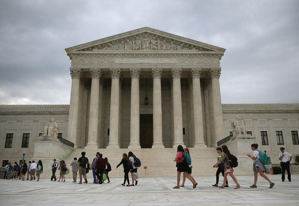 People arrive to attend the final session of the term at the U.S. Supreme Court on June 30 in Washington, D.C.