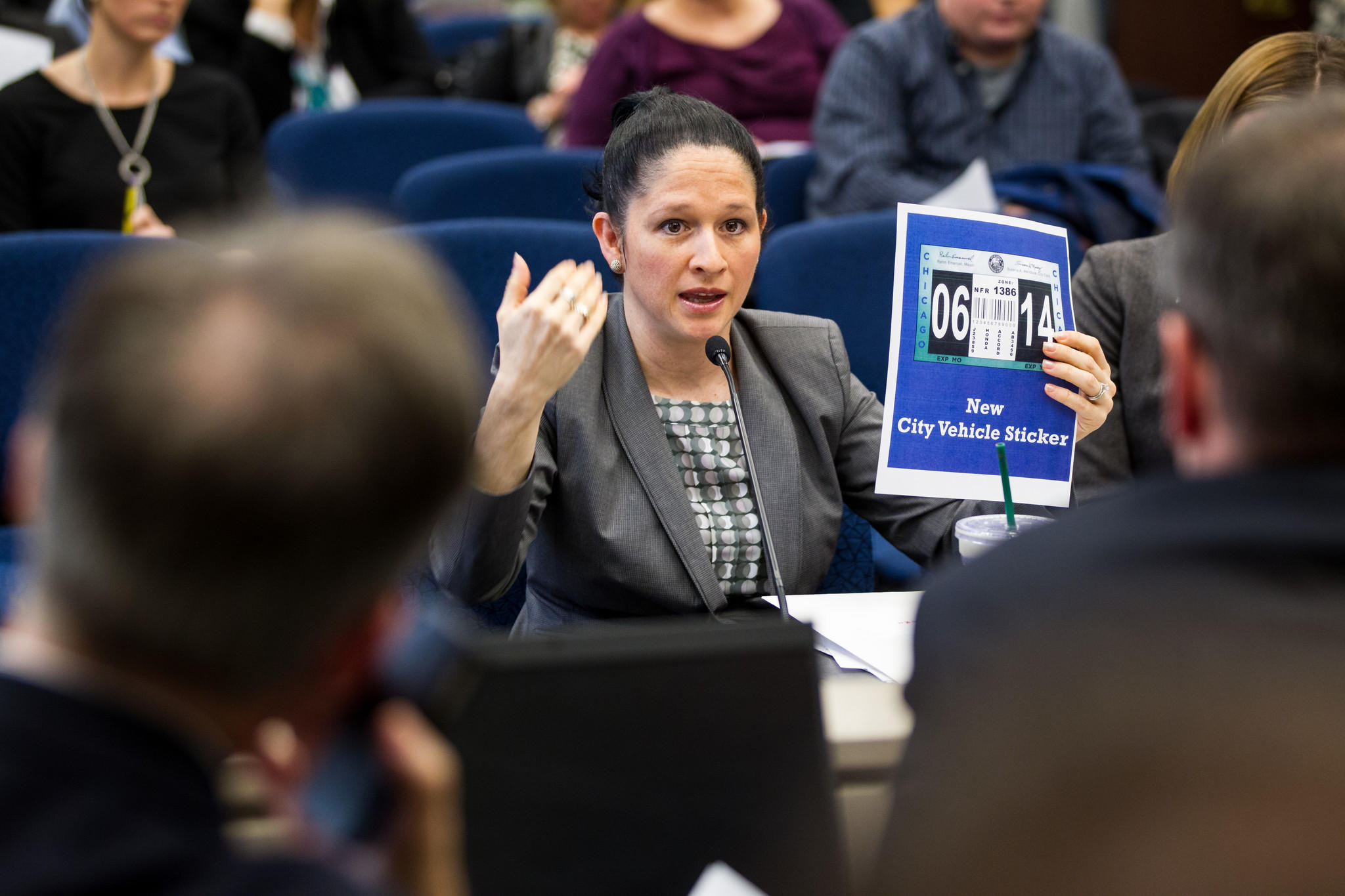 Susana Mendoza, City Clerk of Chicago presents the new city vehicle sticker to members of the Committee on License and Consumer Protection.