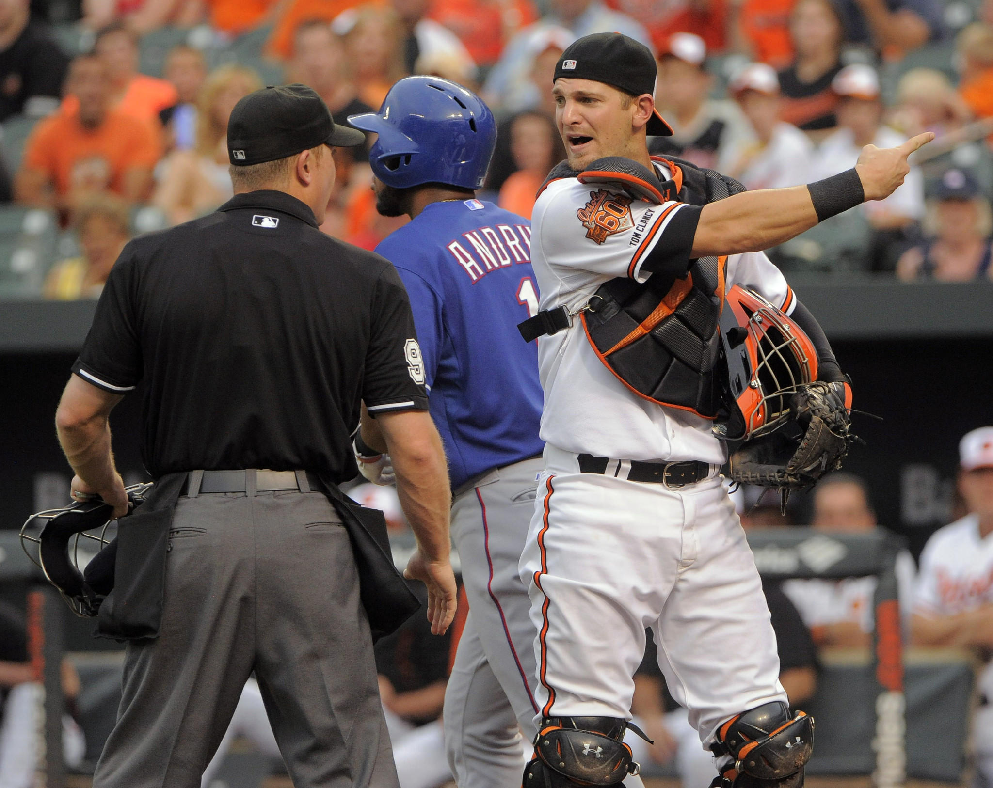 Orioles catcher Caleb Joseph, right, argues with home plate umpire Toby Basner after he was called for catcher's interference with the Texas Rangers' Elvis Andrus, background, up to bat at Camden Yards.