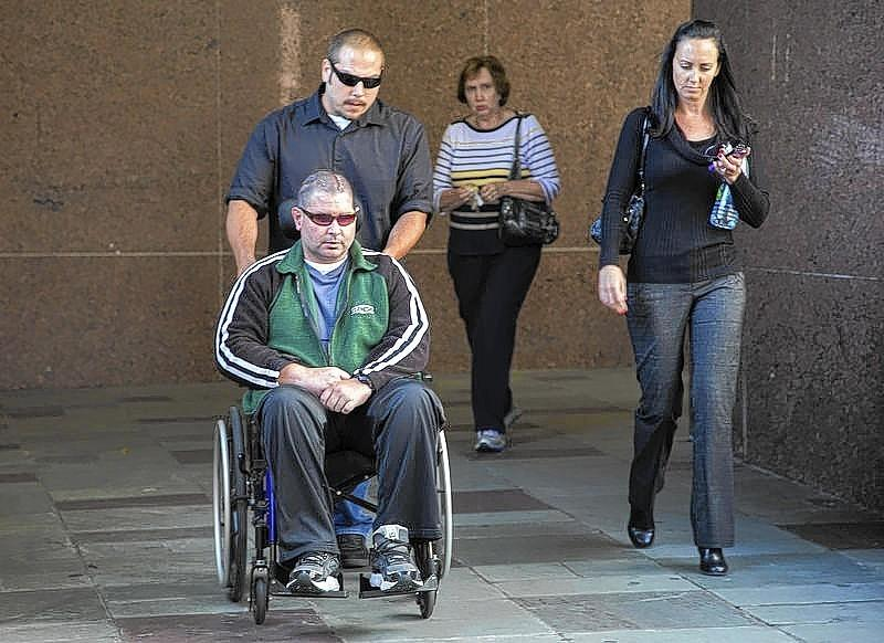 San Francisco Giants fan Bryan Stow leaves a Los Angeles Court with his sister Bonnie and his mother Ann