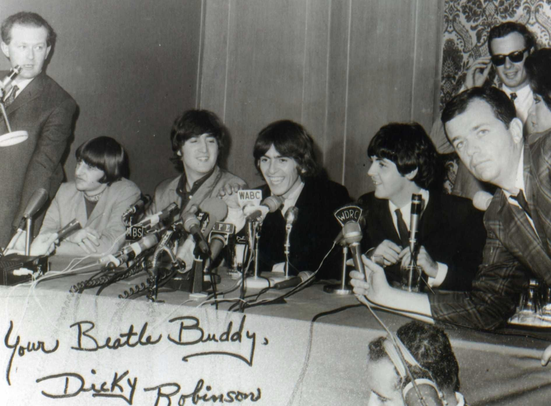 Former WDRC personality Dick Robinson (on the right holding microphone), was one of a handful of select broadcasters invited to attend the Beatles' press conference at the St. George Hotel in New York in 1964. After the press conference, he also met privately with the Fab Four. Also shown in the picture taken that day are Ed Sullivan and his recording crew, Movie Tone News reps, and Brian Epstein, the Beatles' manager, shown in the photo's background.