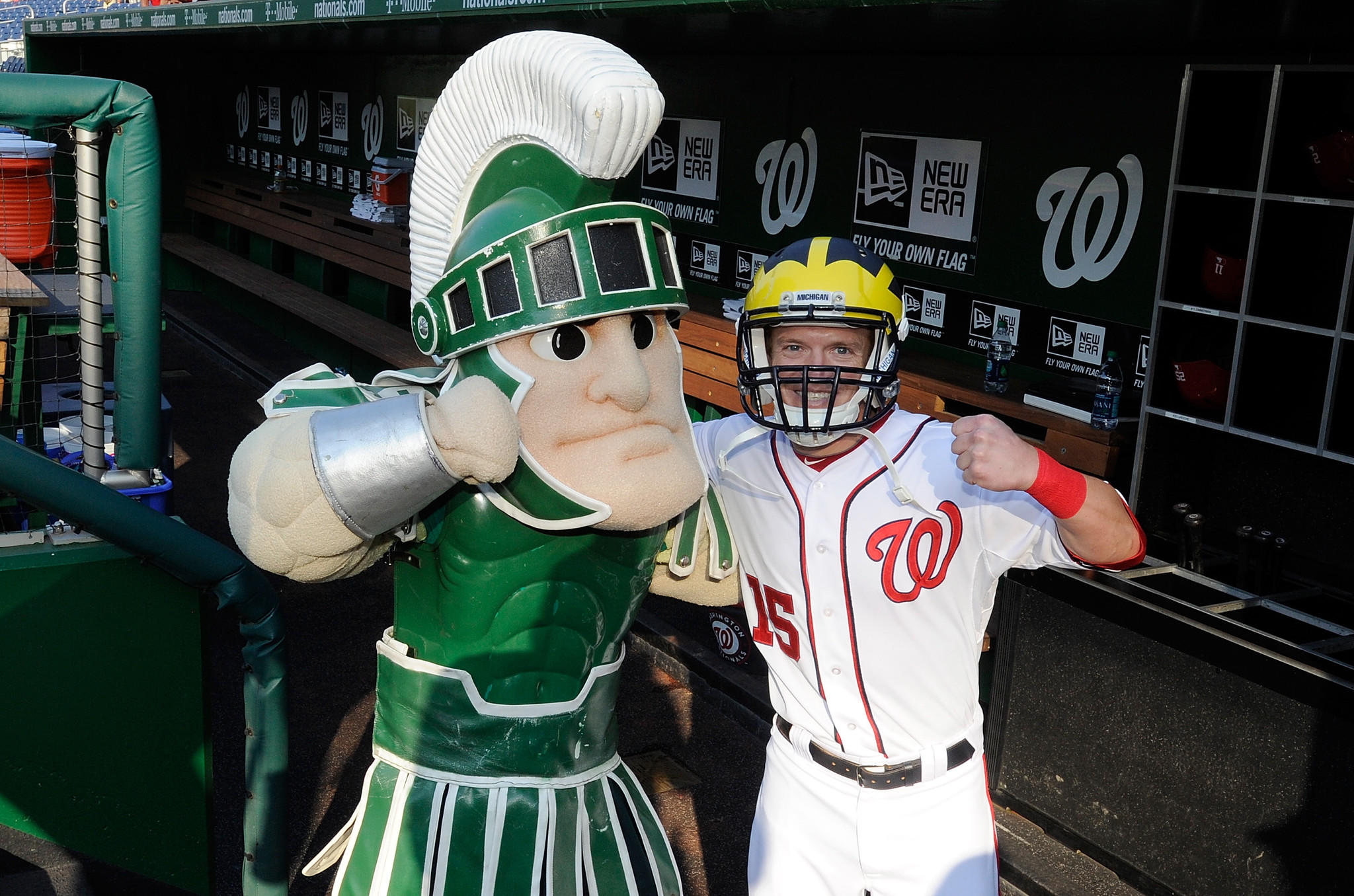 Washington Nationals outfielder Nate McLouth wears a Michigan football helmet as he poses with Michigan State's mascot before a game Monday.