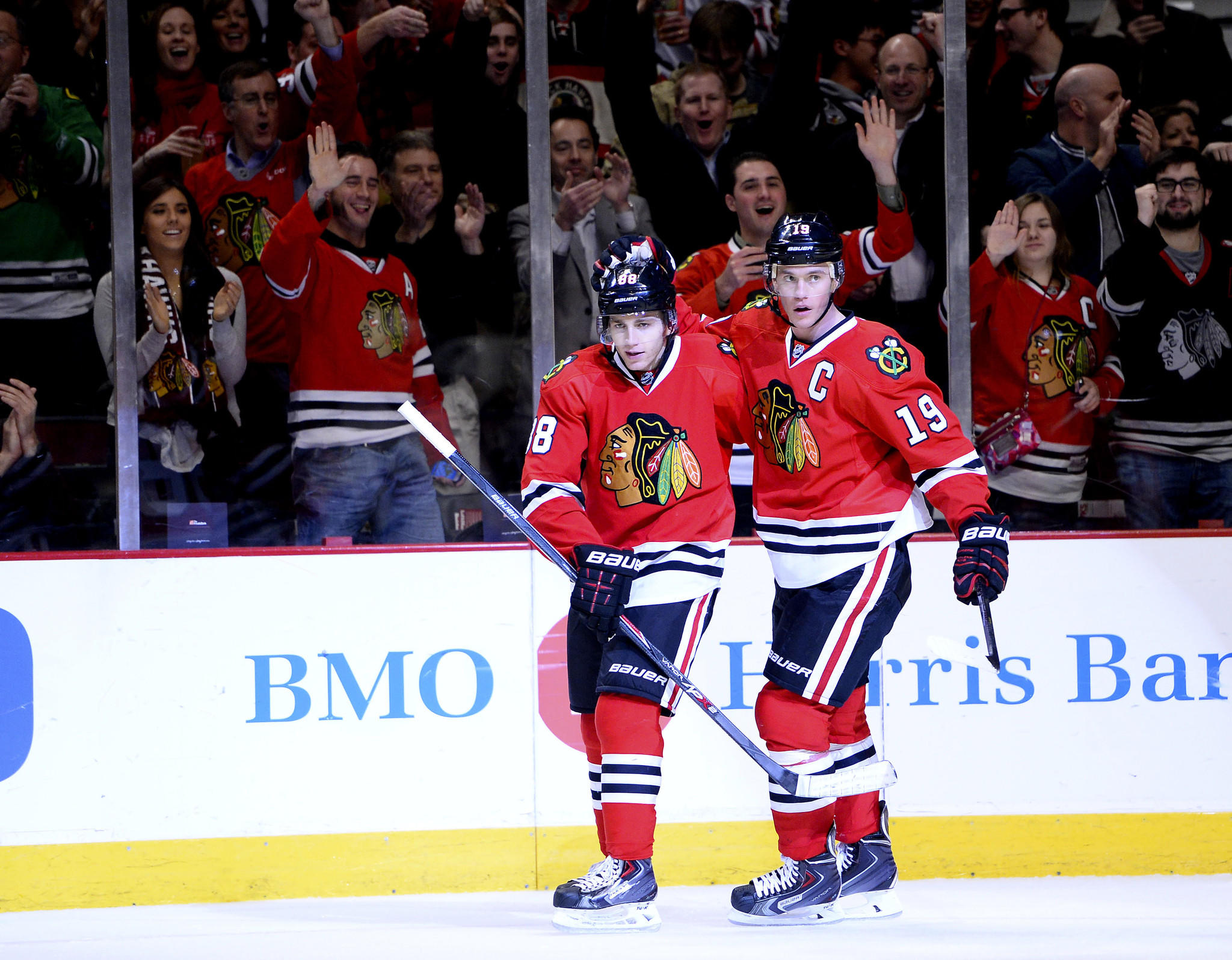 Blackhawks center Jonathan Toews (right) reacts with right wing Patrick Kane (left) after scoring a goal.