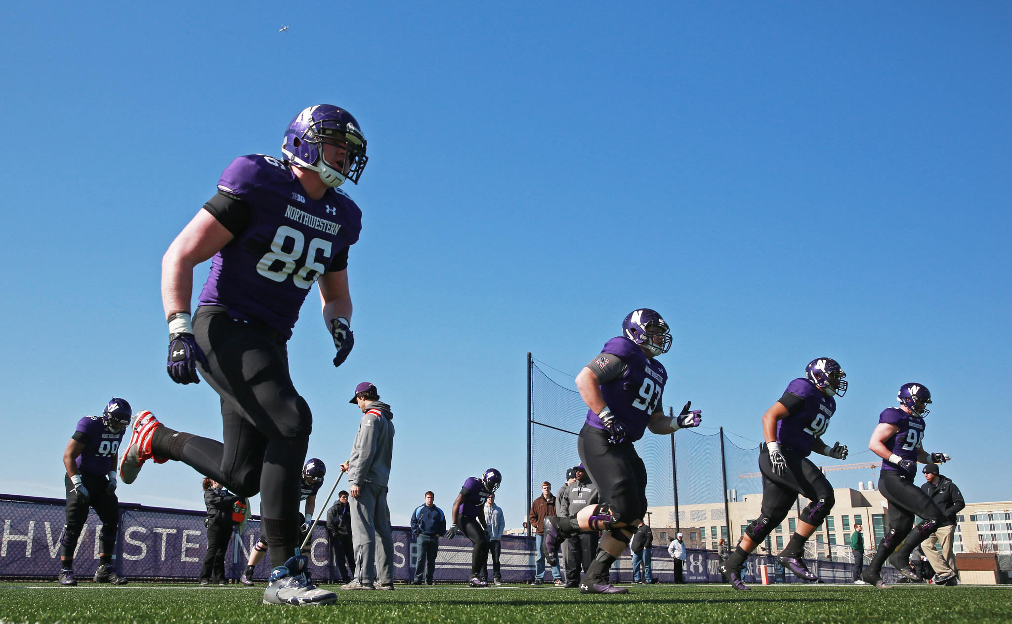 Northwestern University defensive tackles run drills during a spring practice in April.