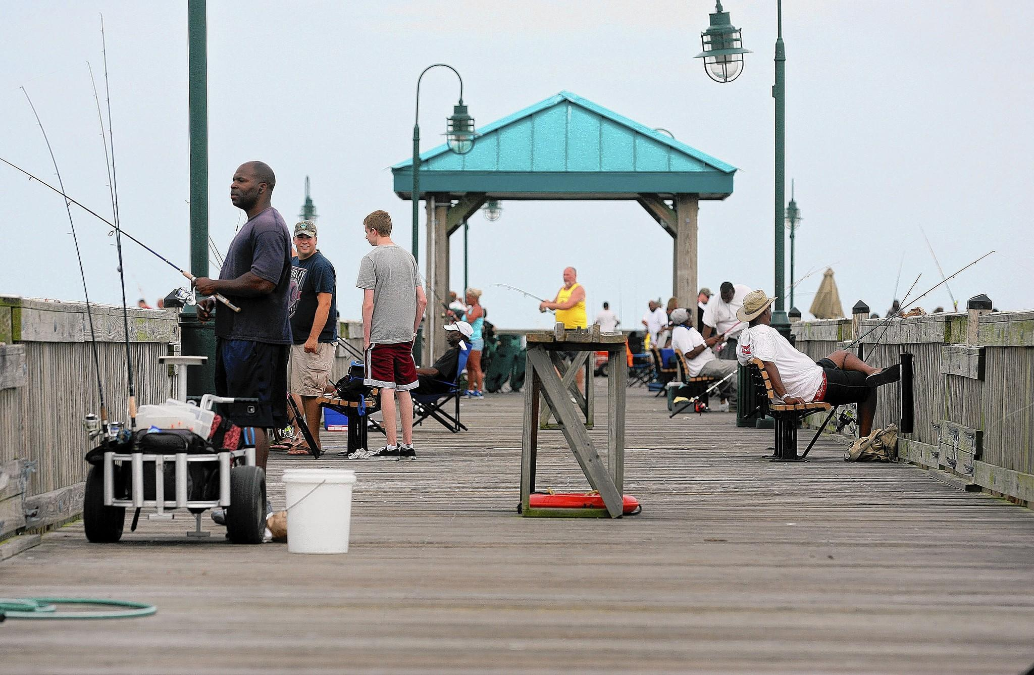 It was business as usual at the Buckroe Fishing Pier on Thursday evening as Hurricane Arthur churned in the Atlantic to the southeast.