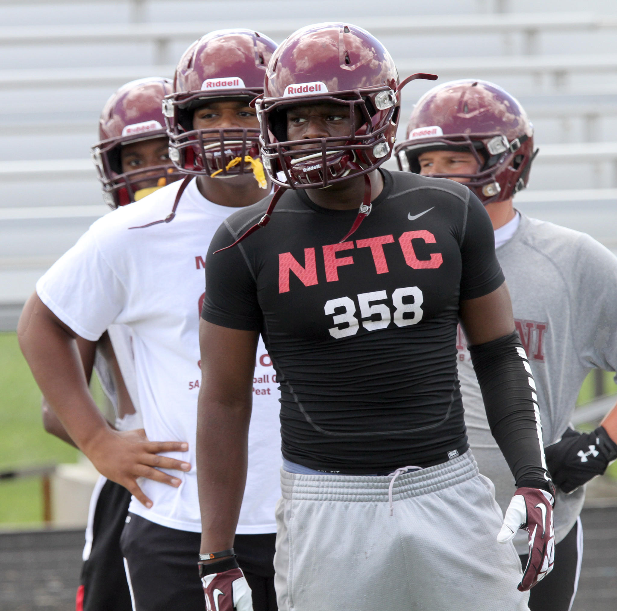 Nile Sykes works out with Montini Catholic High School.