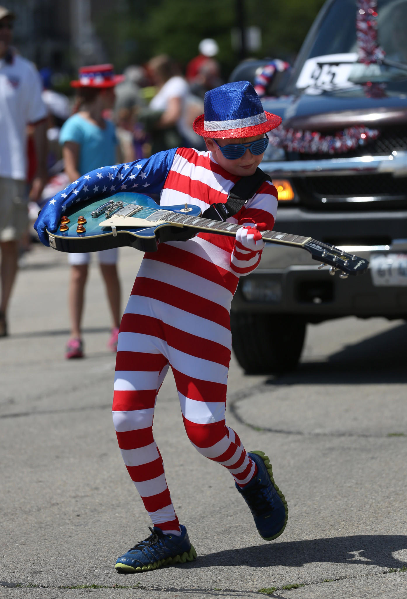 Aidan Dufty, 10, dresses appropriately for his participation in the 4th of July parade in Wheaton, Friday July 4, 2014. (Abel Uribe/ Chicago Tribune)