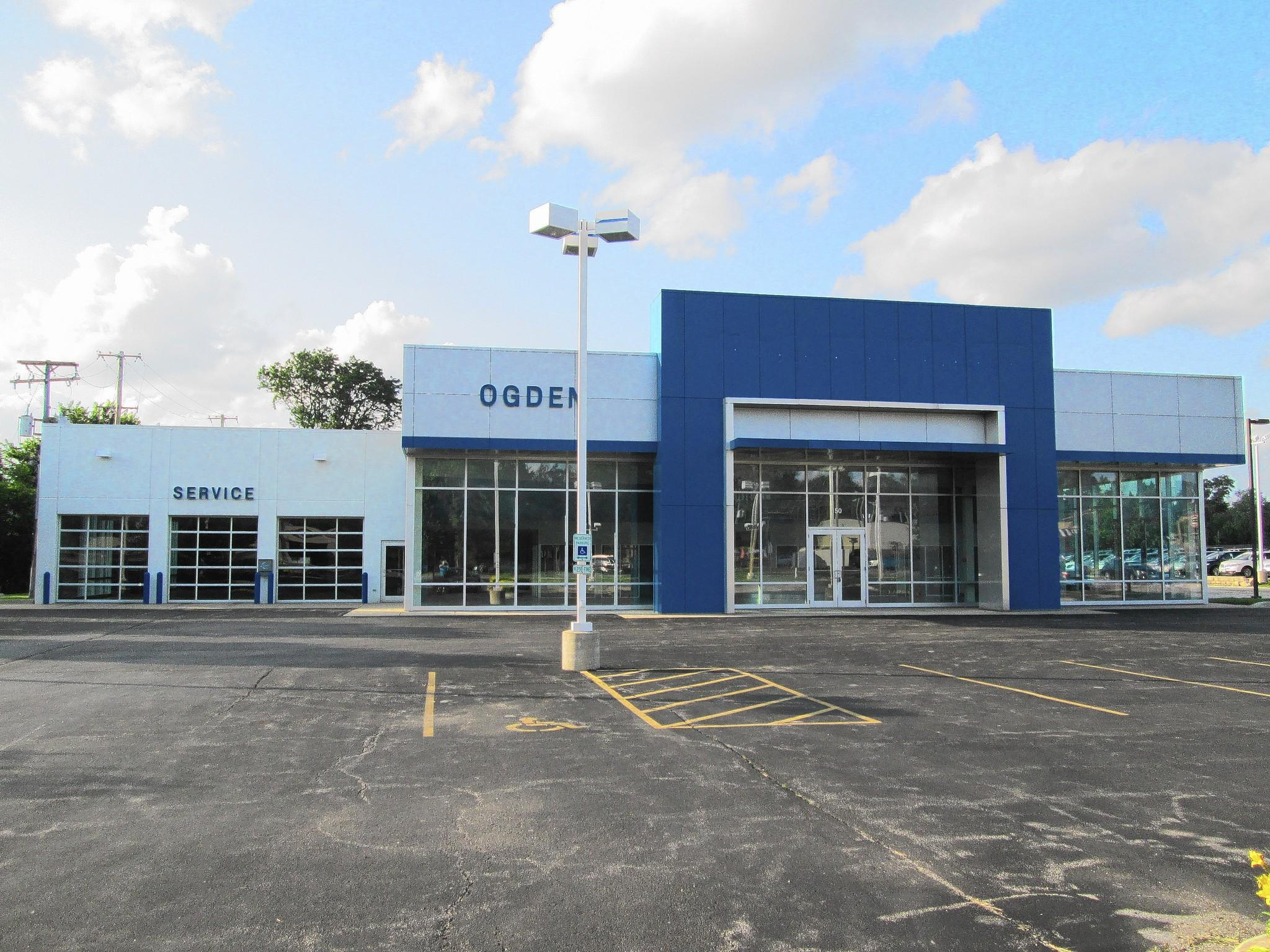 A luxury car and motorcycle dealership is moving into the former Chevrolet site.