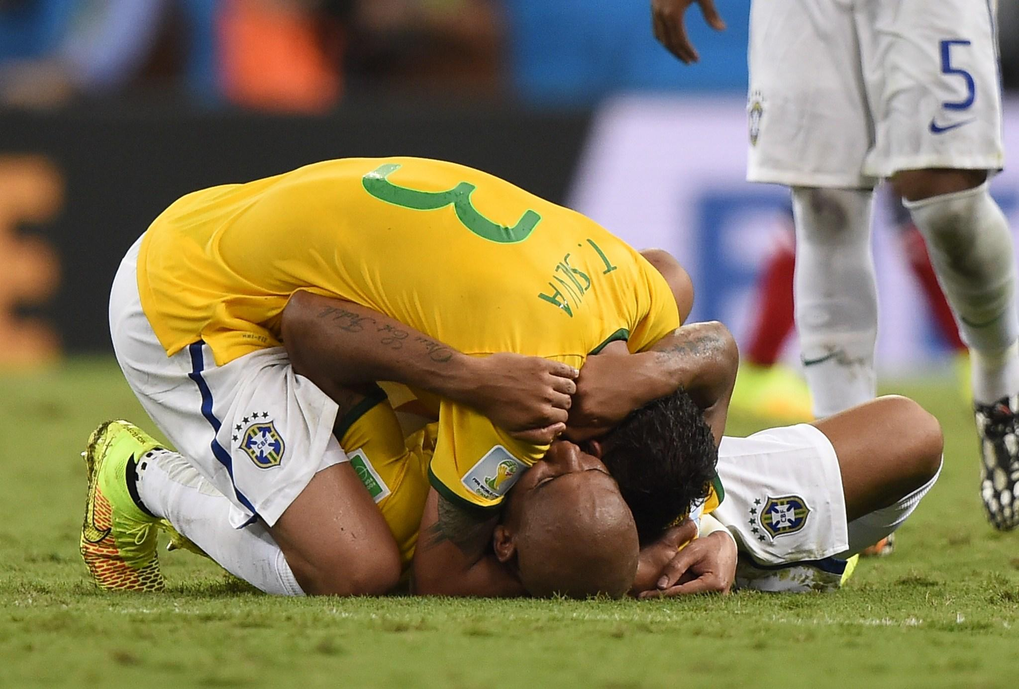 Brazil's defender and captain Thiago Silva celebrates with Brazil's defender Maicon after the quarter-final football match.
