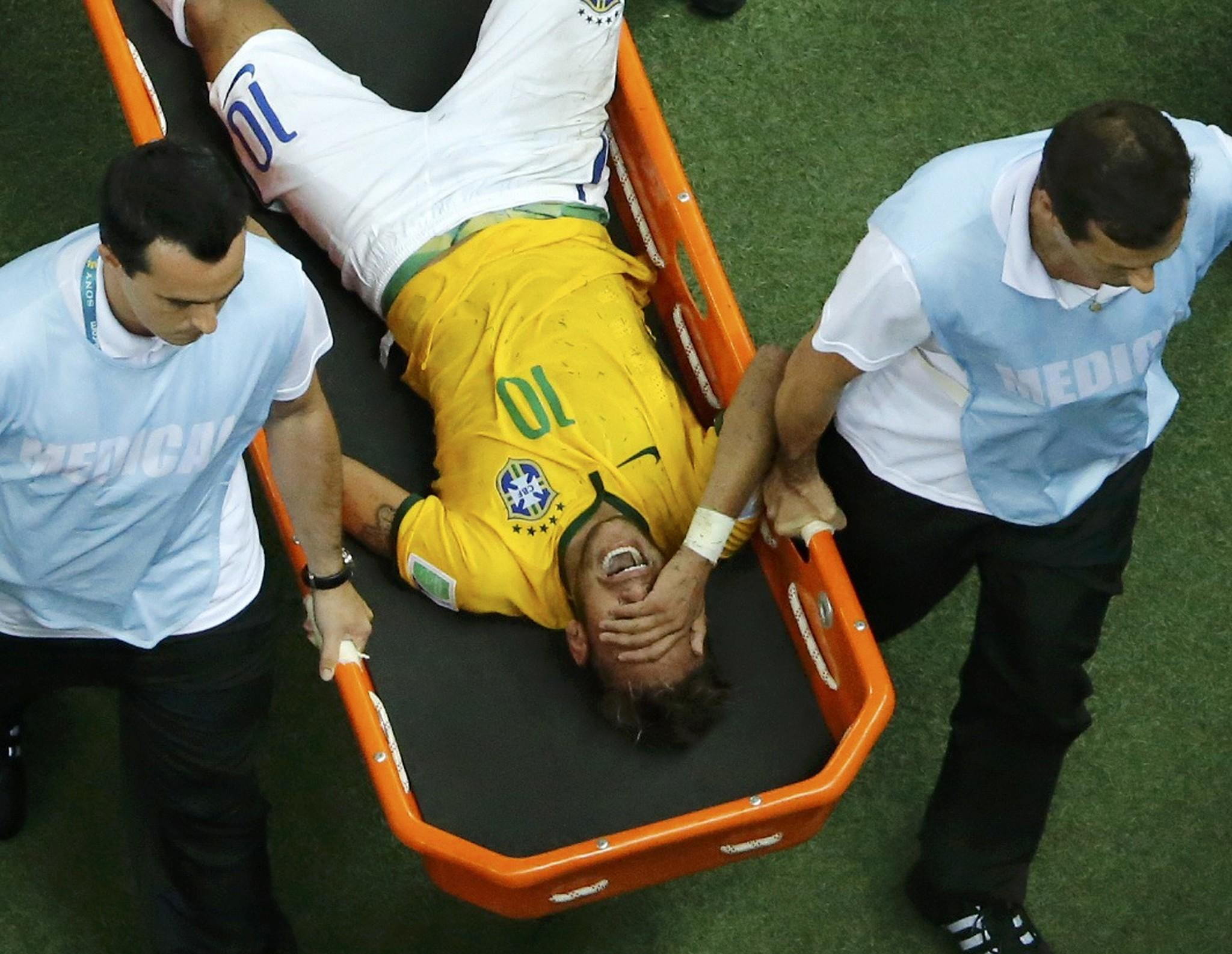 Brazil's Neymar grimaces as he is carried off the pitch after being injured.