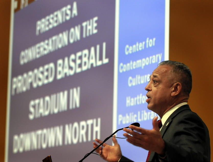 Hartford Mayor Pedro Segarra speaks at a standing-room-only public hearing about the proposed baseball stadium for downtown Hartford on July 2 at the Hartford Public Library.