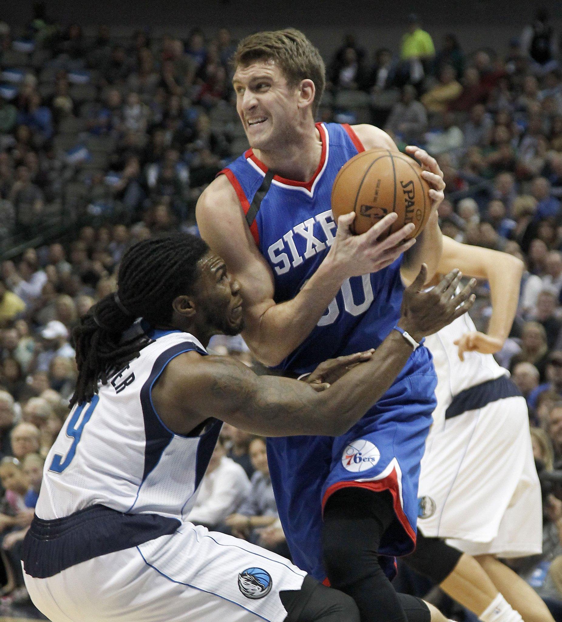 Jae Crowder of the Dallas Mavericks pressures Spencer Hawes of the Philadelphia 76ers.