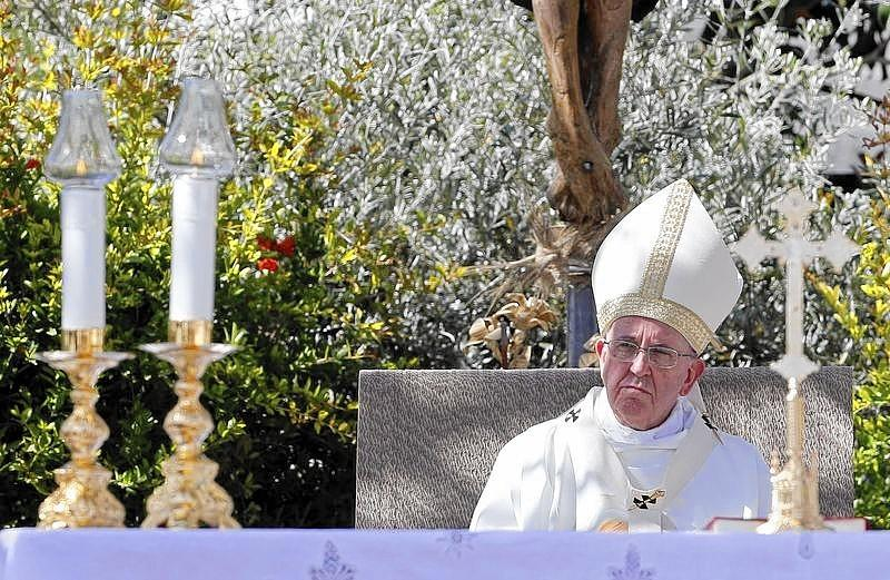 Pope Francis looks on as he leads a mass in Campobasso, south of Italy.