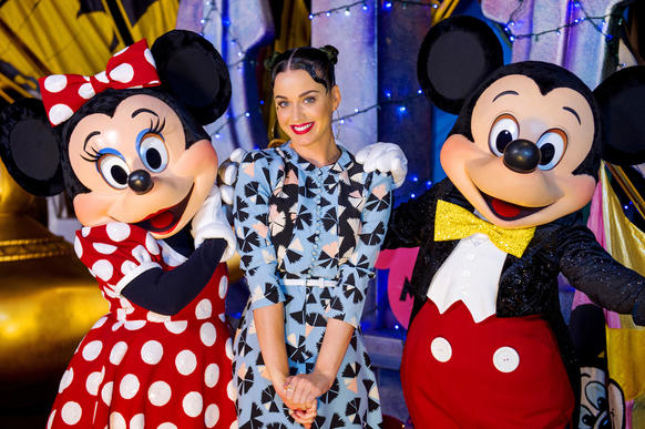 Singer Katy Perry poses July 4, 2014 with Minnie Mouse and Mickey Mouse at Disney's Hollywood Studios at Walt Disney World Resort.