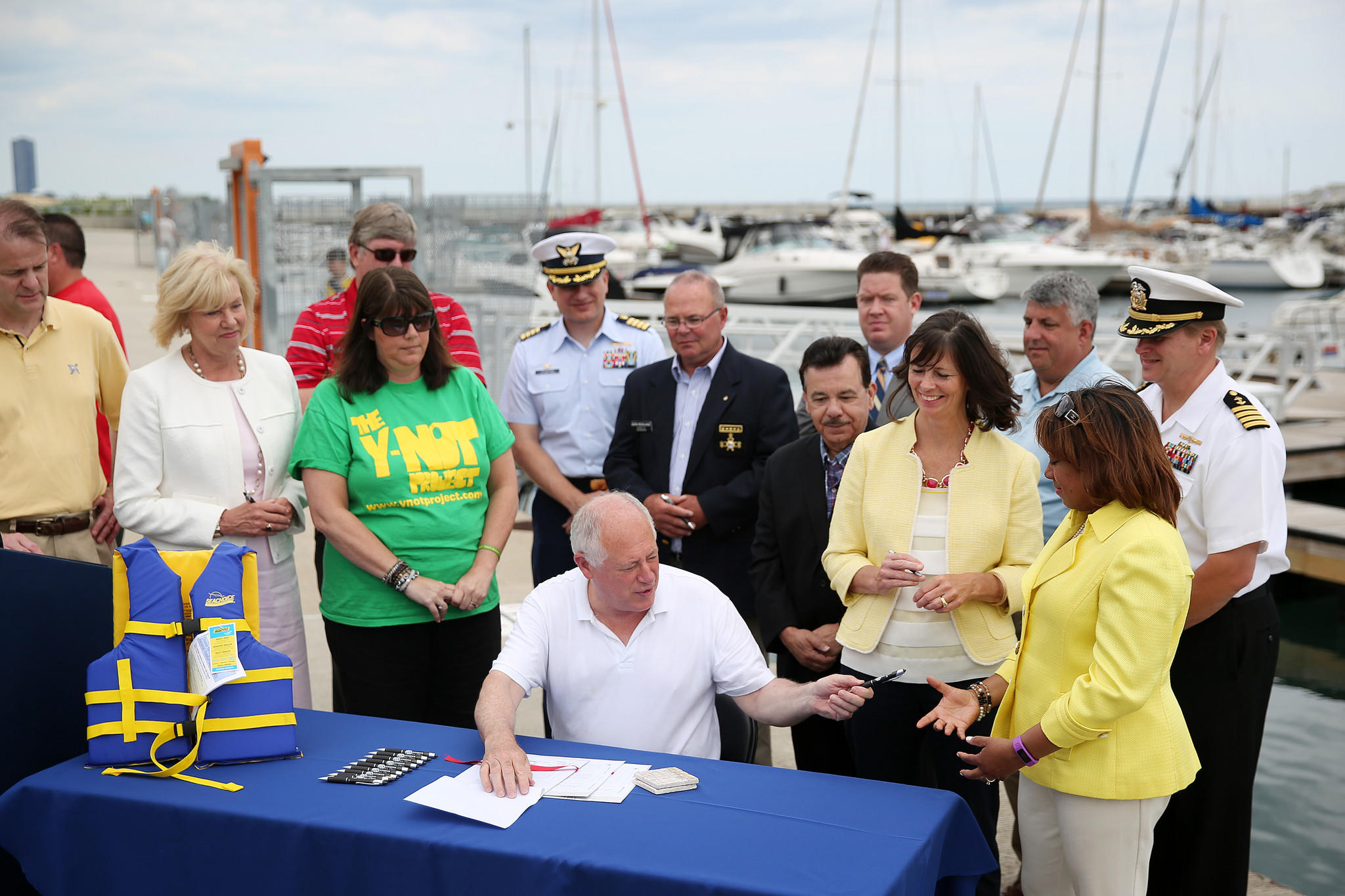 Gov. Pat Quinn signs legislation to increase water safety in state waterways on at 31st Street Harbor in Chicago.