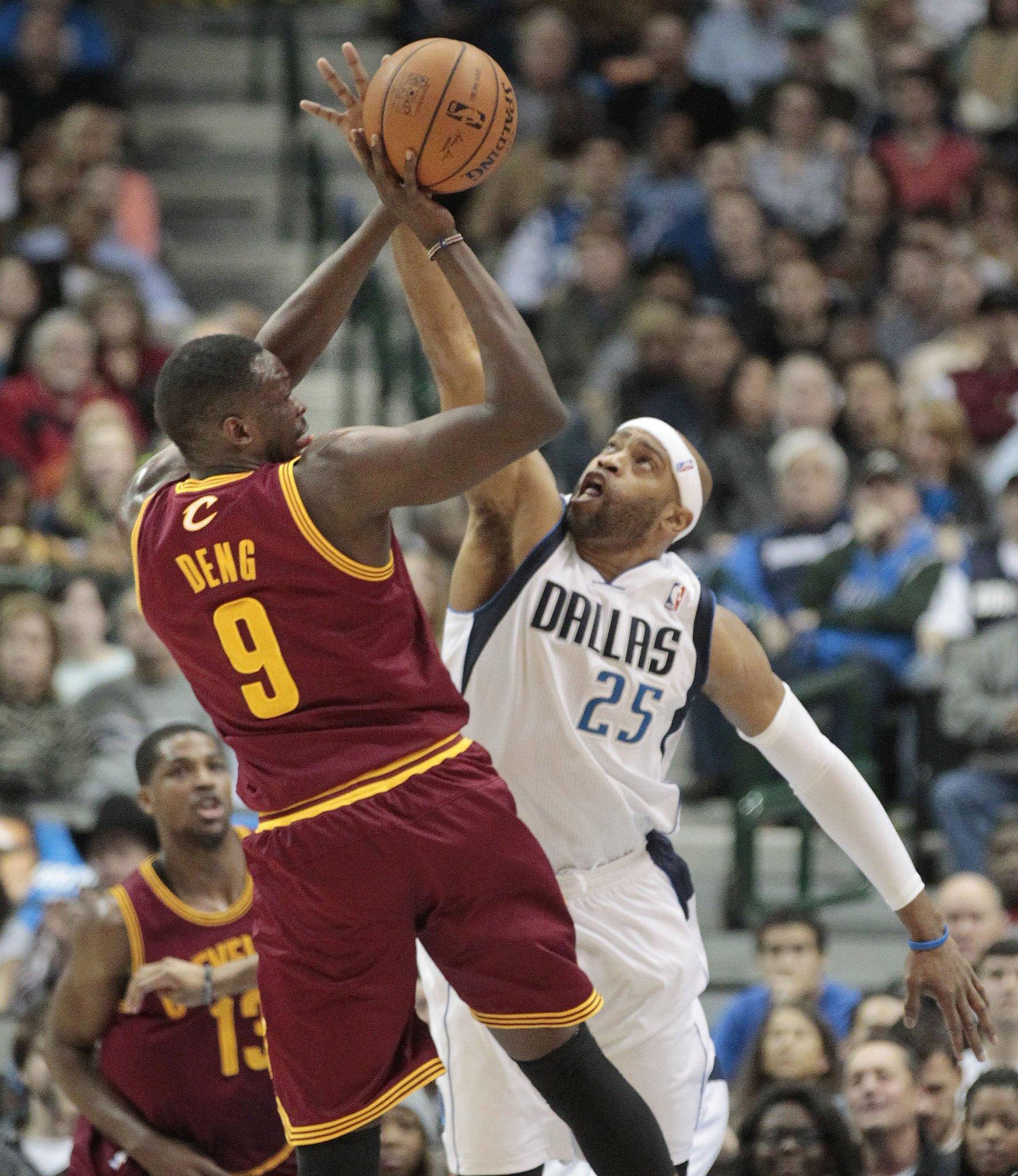 Dallas Mavericks' Vince Carter tries to block Cleveland Cavaliers' Luol Deng.