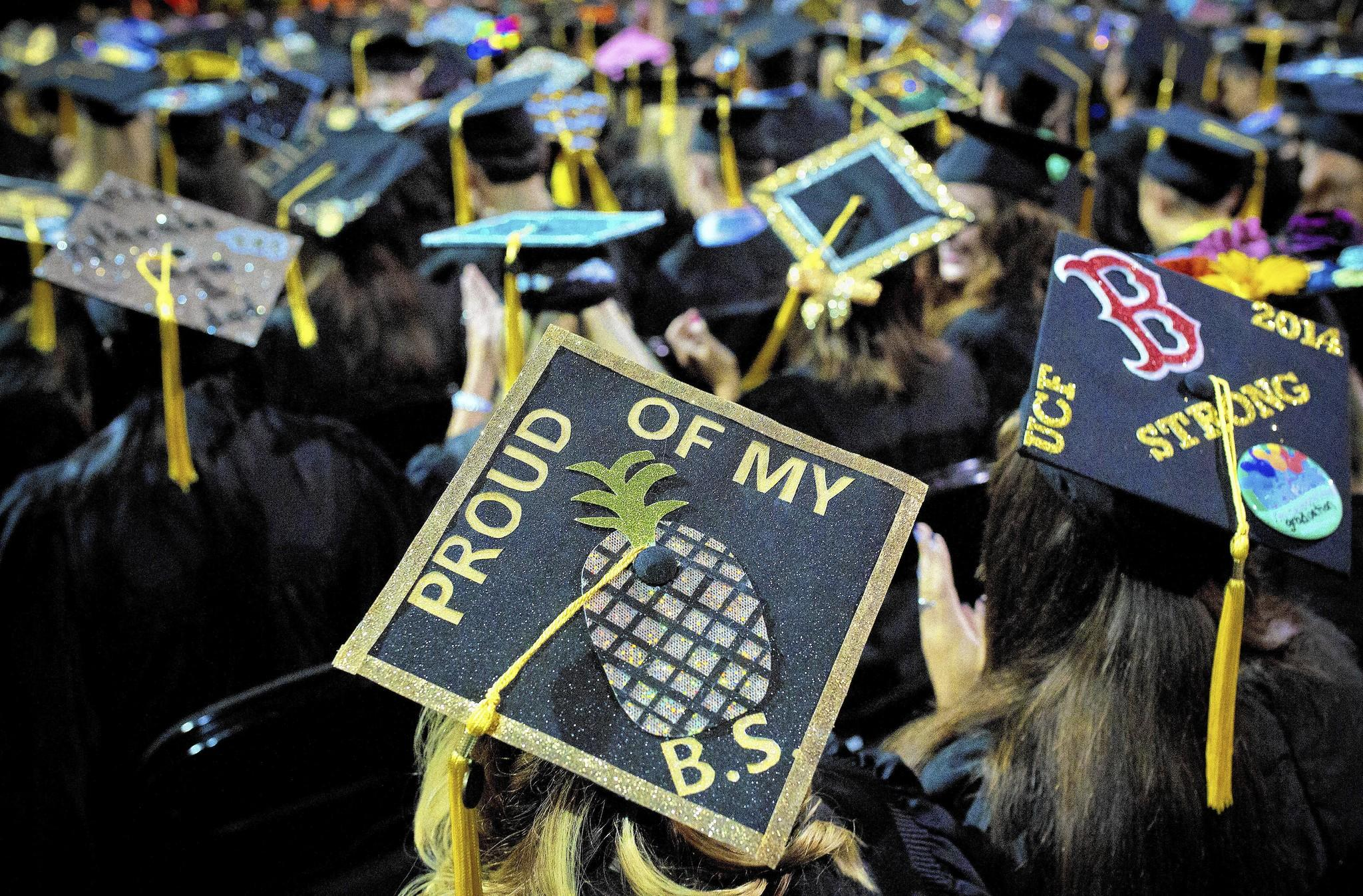 Graduates show off their style with messages on their caps during a UCF commencement ceremony.
