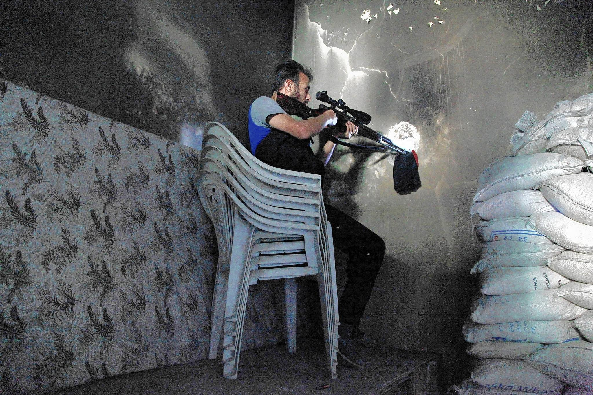 A Free Syrian Army sniper sits in a shooting position. Considered more moderate and secular than other rebel factions, the Free Syrian Army would be a part of an effort proposed by the Obama administration. The proposal includes a $500 million program to train and arm moderate Syrian rebels.