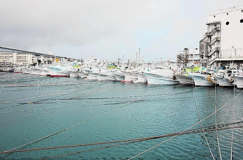 Fishing boats are moored at Tomari port in Naha on Japan's southern island of Okinawa as Super Typhoon Neoguri approaches the region on July 7.