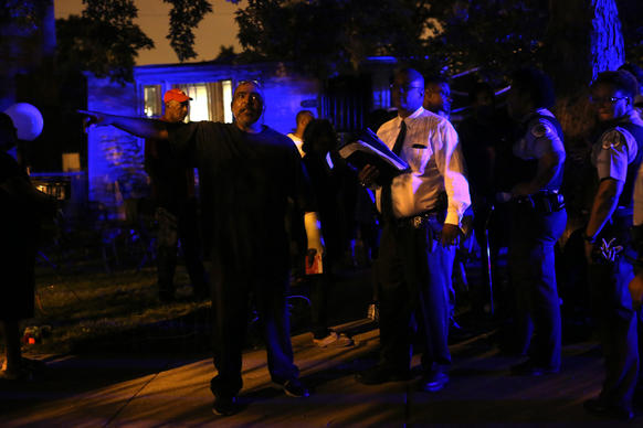 A resident vents his frustration to police investigating the shooting of his niece during a backyard cookout on 10900 block of South Throop Street early Monday.