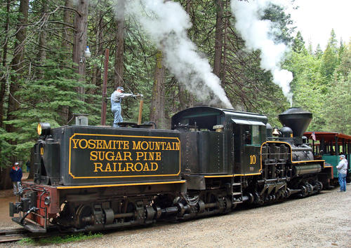 A Yosemite Mountain Sugar Pine Railroad locomotive takes on water.