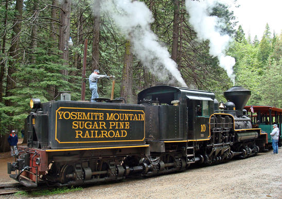 A Yosemite Mountain Sugar Pine Railroad locomotive takes on water.