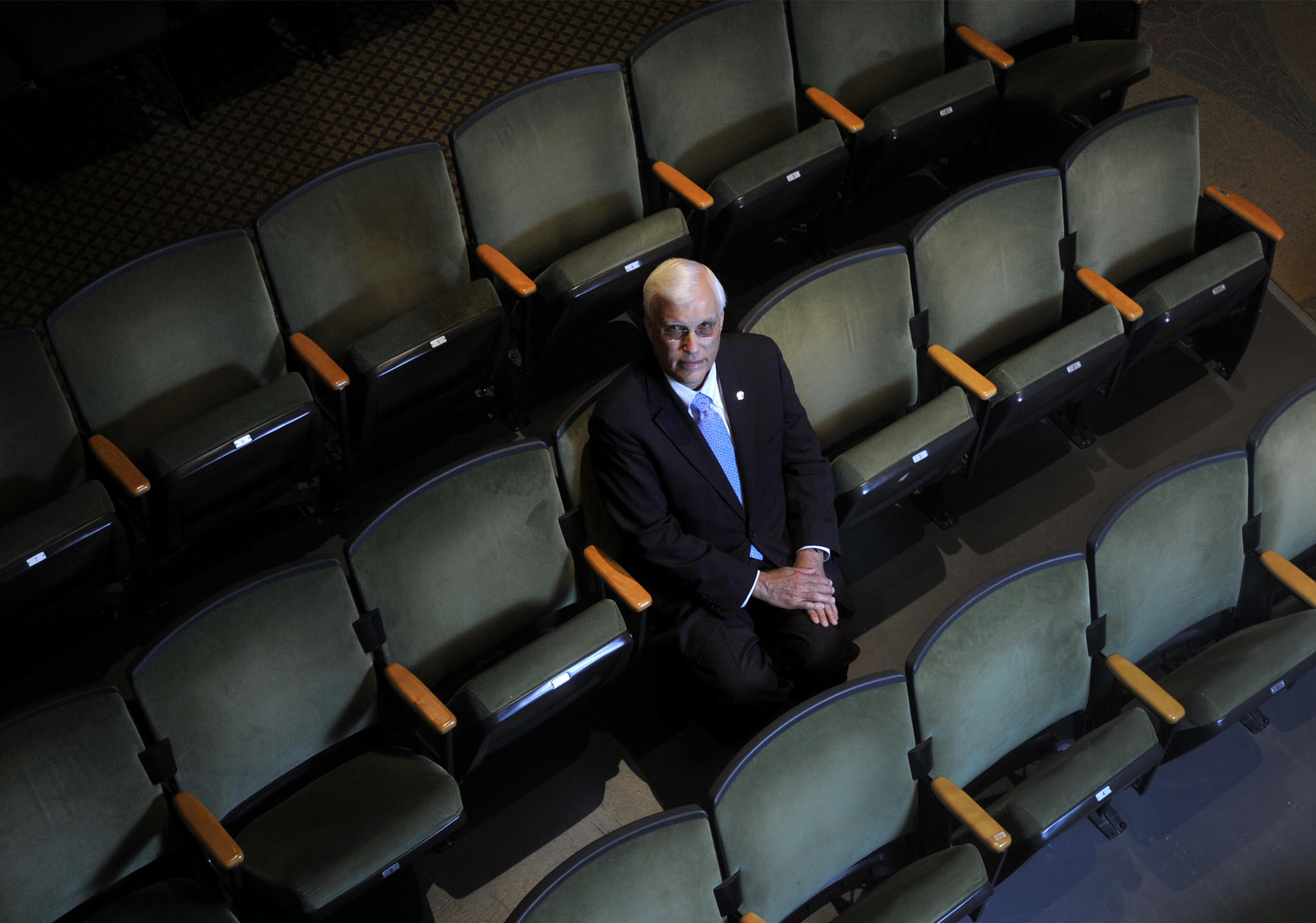 Former UConn dean, David G. Woods, poses for a portrait at Jorgensen Center for the Performing Arts in Storrs.