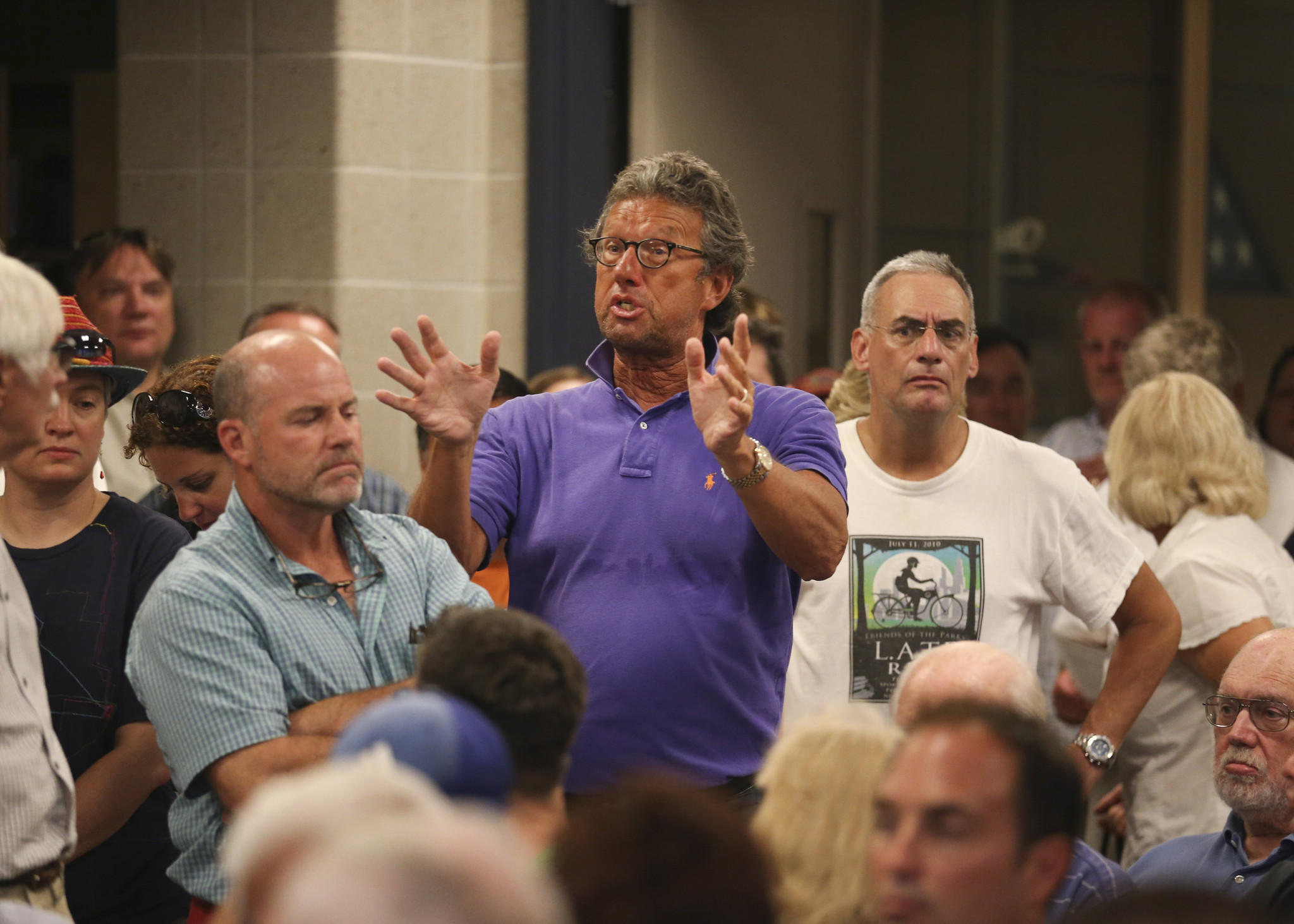 Lakeview residents met with representatives of the Chicago Cubs at the 19th District Police Station Monday night to discuss concerns about the proposed Wrigley Field renovations.