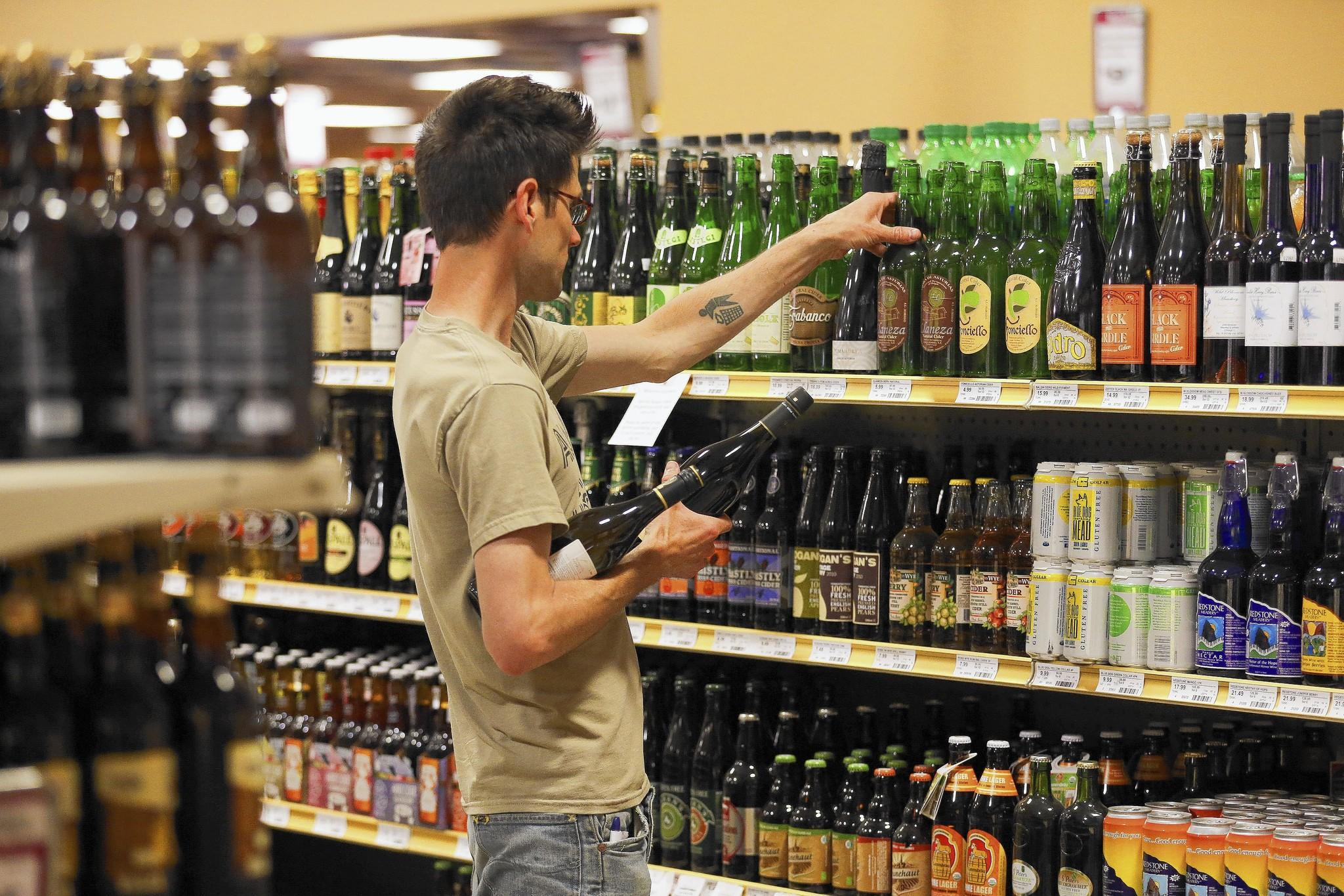 Ben Walker, of Chicago, shops for cider at Binny's at 1720 N. Marcey St. The alcoholic drink, made from fermented apple juice, is staging what some consider to be a long overdue comeback in America.