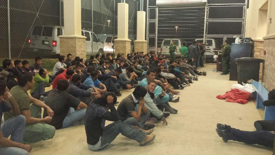 Illegal immigrants are seen at a U.S. Department of Health and Human Services facility in South Texas in this handout photo courtesy of the office of U.S. Representative Henry Cuellar (D-TX).