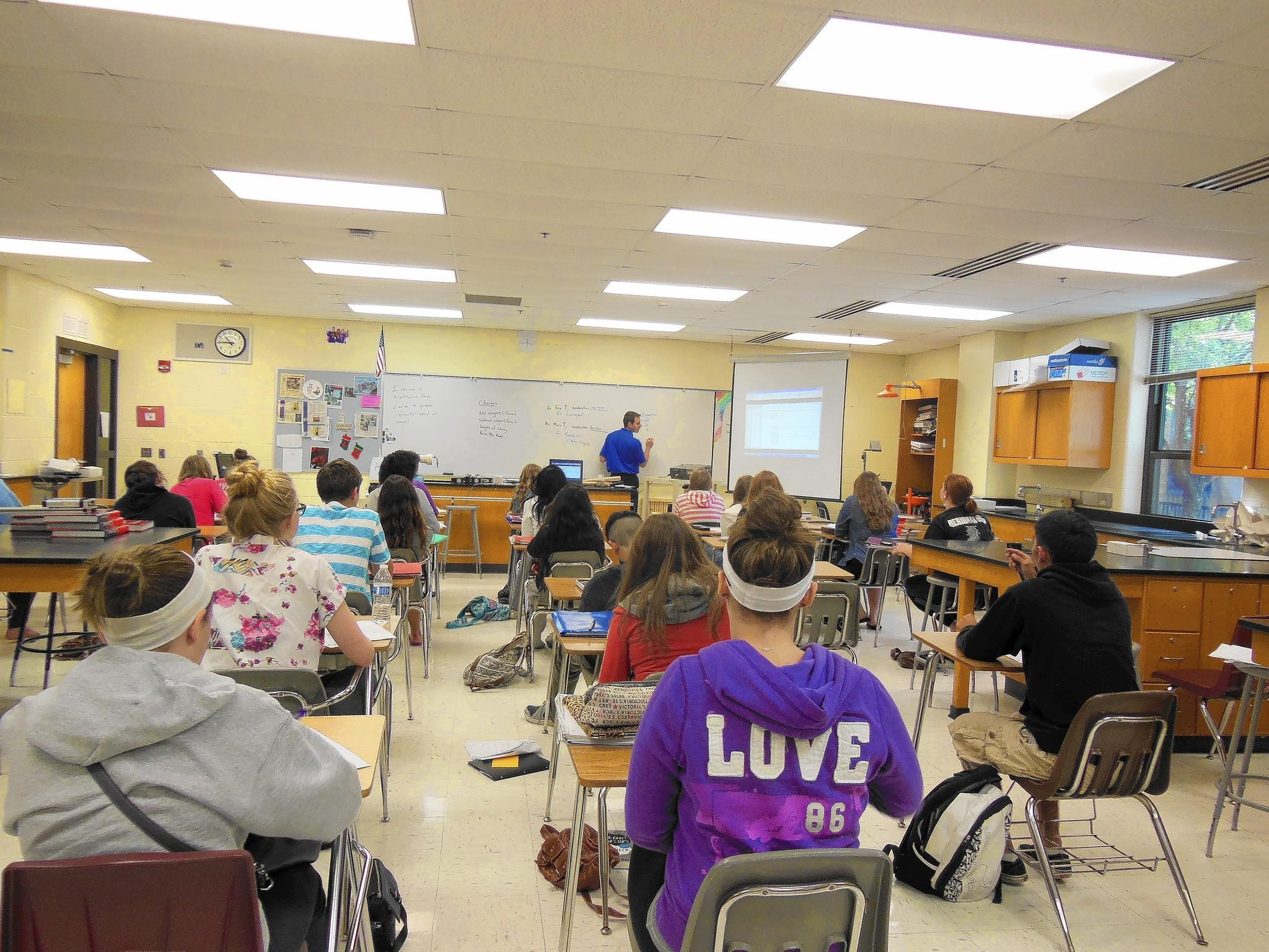 Ryan Lodes teaches a physics class this summer at Lincoln-Way East.