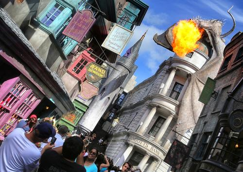 The fire-breathing dragon, perched on top of Diagon Alley, as seen during the grand opening at the Wizarding World of Harry Potter expansion, at Universal Studios Florida, in Orlando,  Tuesday, July 8, 2014.  (Joe Burbank/Orlando Sentinel)  B583850553Z.1