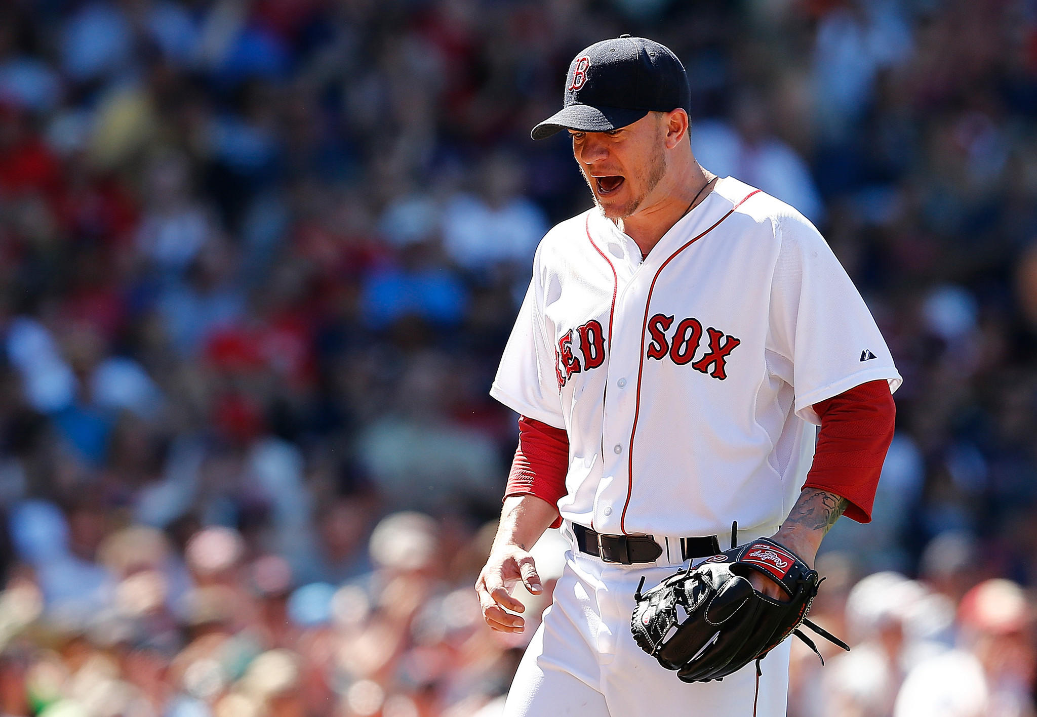 BOSTON, MA - JULY 6: Jake Peavy #44 of the Boston Red Sox reacts after pitching in the sixth inning the Baltimore Orioles to fly out at Fenway Park on July 6, 2014 in Boston, Massachusetts. (Photo by Jim Rogash/Getty Images) ORG XMIT: 477586067