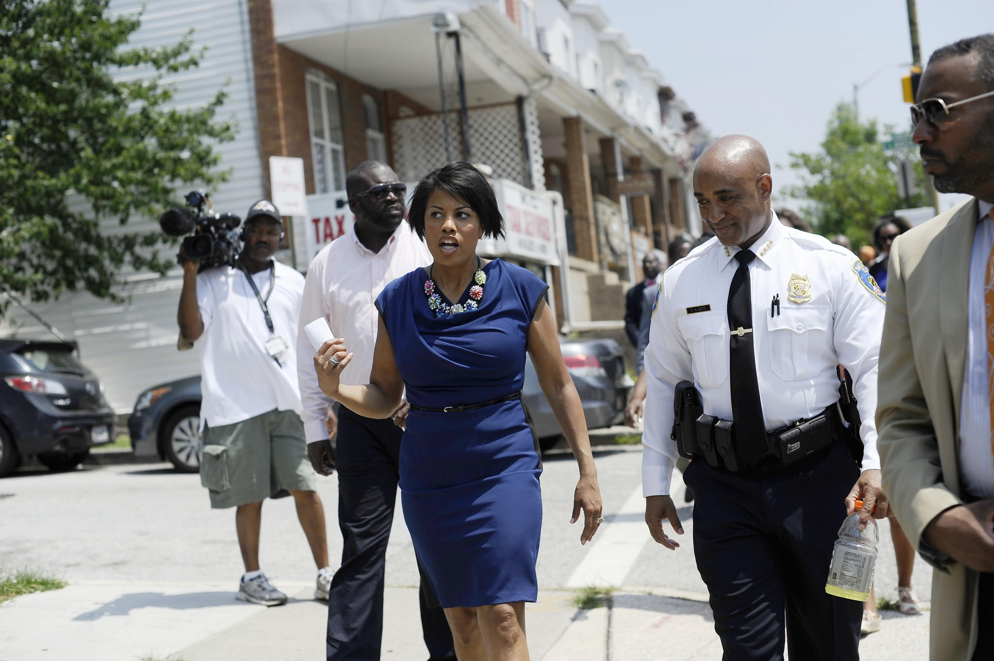 From left, Mayor Stephanie Rawlings-Blake and Baltimore Police Commissioner Anthony Batts walk on Belair Road Tuesday morning after a press conference about public safety initiatives and the recent reductions in violent crime.