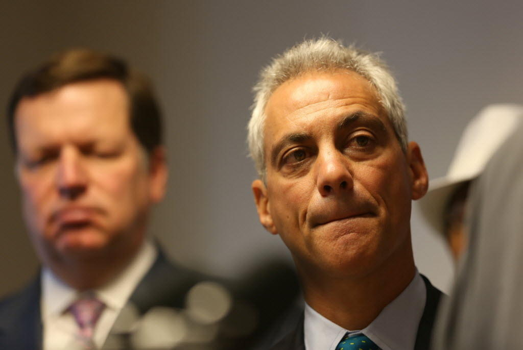 Mayor Rahm Emanuel, seen here at a Tuesday news conference on minimum wage, wants the Cubs and rooftop owners to avoid a lawsuit.