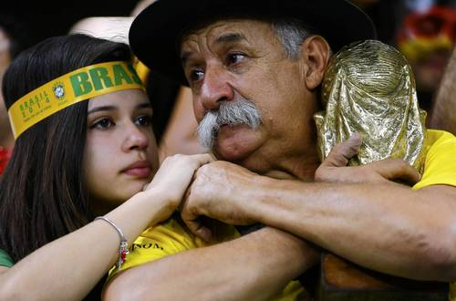 Brazil fans react at the end of the team's loss to Germany.