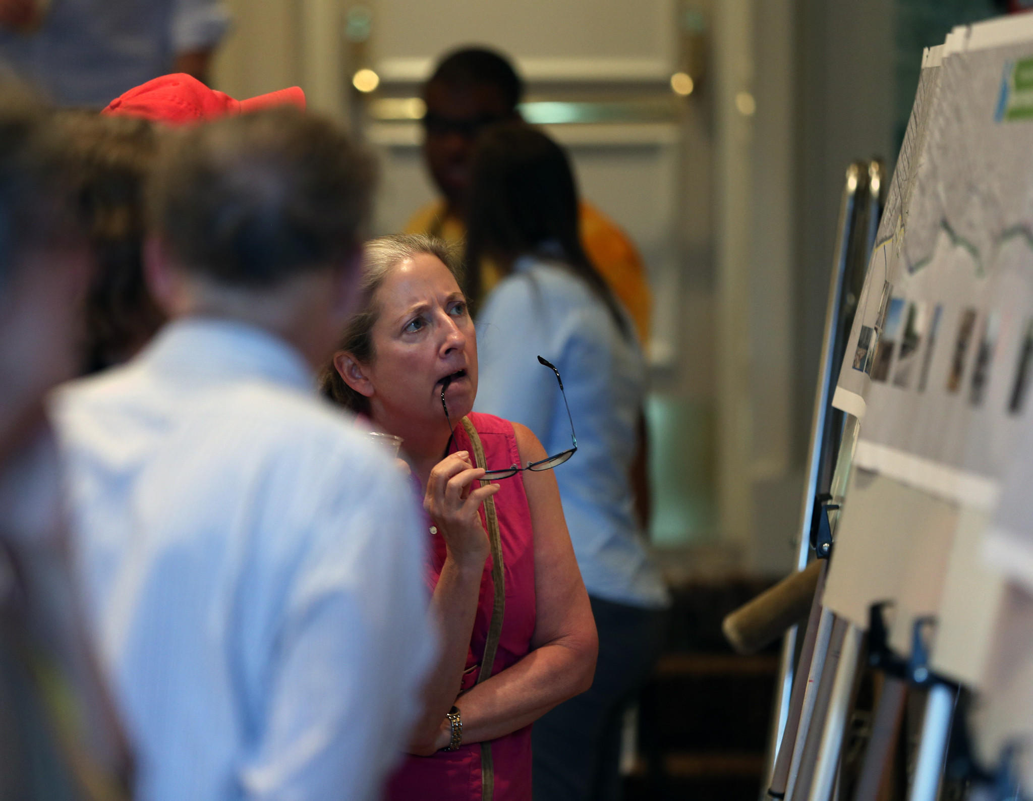 Nora Handler, of the Lakeview neighborhood in Chicago, looks over photos and illustrations of the northern stretch of Lake Shore Drive during a public meeting at the Drake Hotel in Chicago on Tuesday.