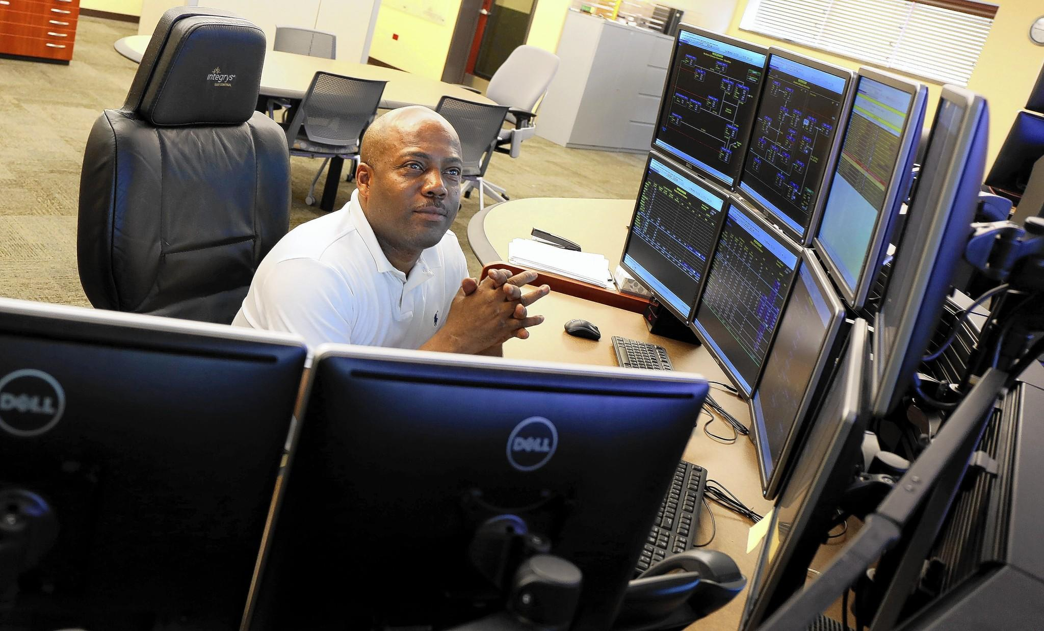 Greg Williams sits at the Integrys control center in Joliet, where gas controllers like himself move gas for utilities in Michigan, Wisconsin, Illinois and Minnesota.