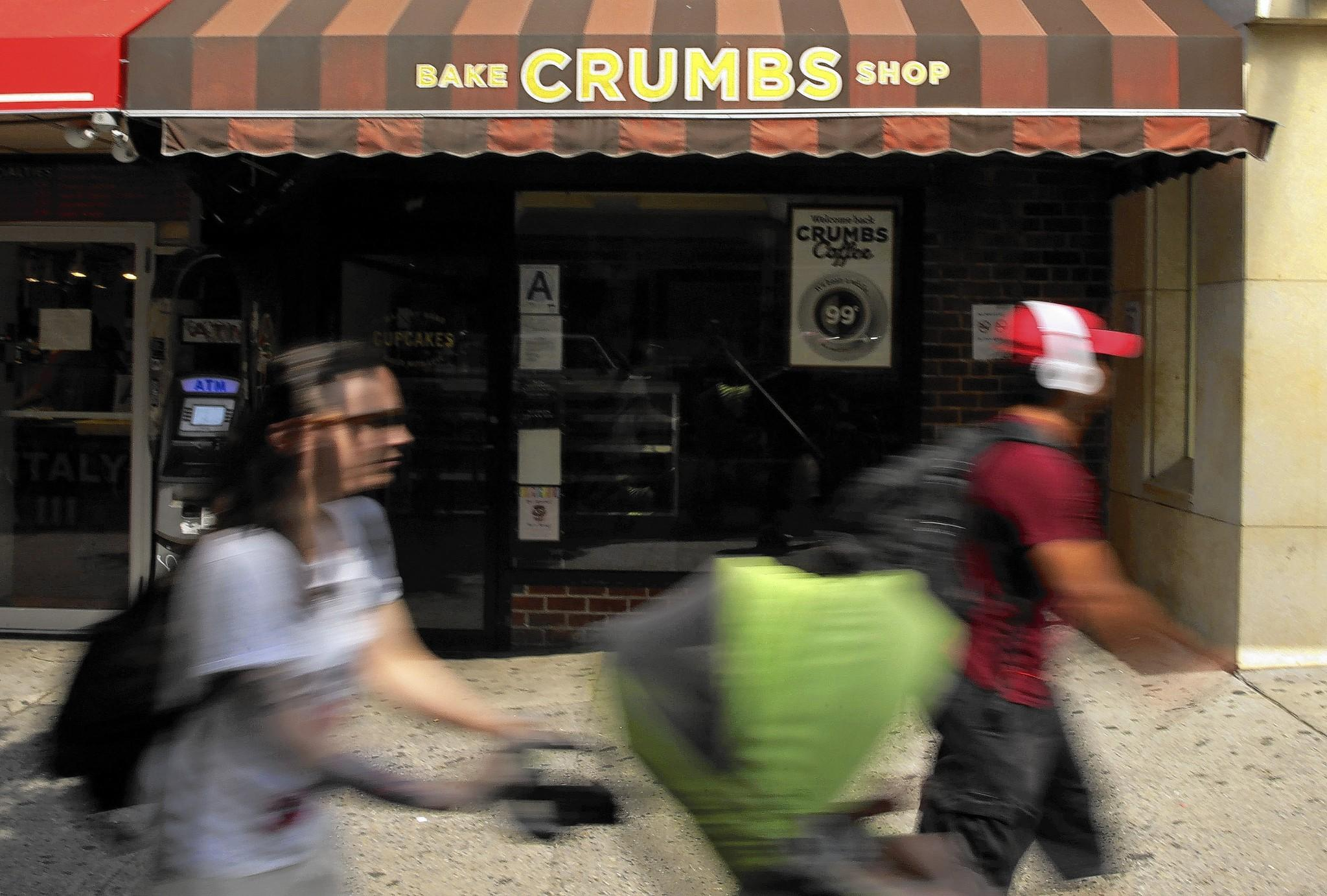 A Crumbs Bake Shop sits empty in New York after the chain closed all its stores this week. Many shops are trying to profit off the U.S. cupcake trend, but demand has waned, a research firm said.