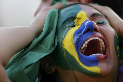 A fan of Brazil reacts while watching a broadcast of the 2014 World Cup semi-final against Germany at the Fan Fest in Brasilia, July 8, 2014.     REUTERS/Ueslei Marcelino (BRAZIL  - Tags:  SOCCER SPORT WORLD CUP)   ORG XMIT: BSB022