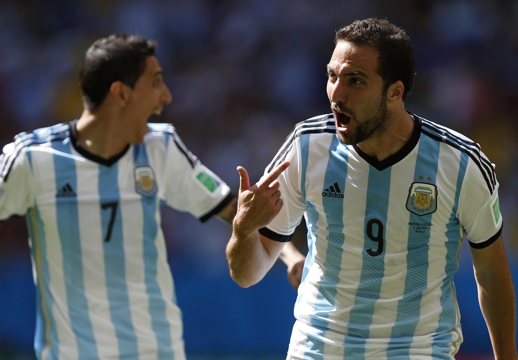 Argentina's Gonzalo Higuain (right) celebrates next to teammate Angel Di Maria after scoring a goal against Belgium during their 2014 World Cup quarter-finals at the Brasilia national stadium in Brasilia July 5, 2014.
