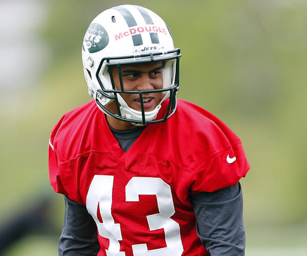 Cornerback Dexter McDougle of the New York Jets gets set to run a play during the first day of rookie minicamp.