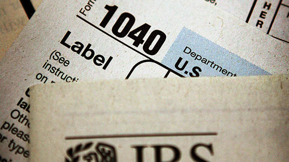 Federal tax forms are distributed at the offices of the Internal Revenue Service in Chicago in this 2005 file photo.
