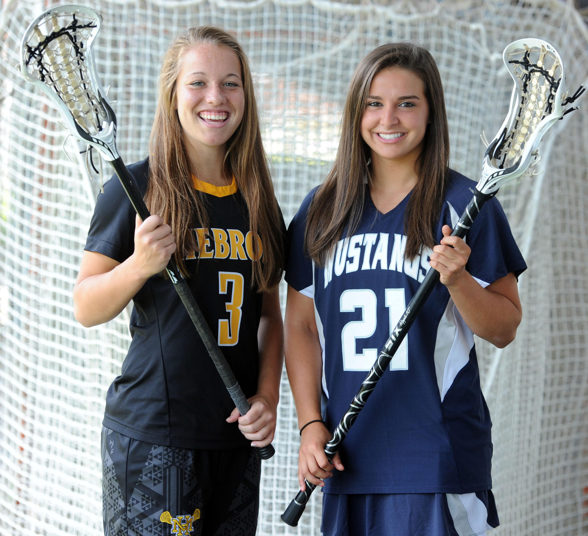 Left to right, Mount Hebron defender Tianna Wallpher and Marriotts Ridge midfielder Taylor Hensh, both All-Metro players who went head-to-head for four years in one of the area's fiercest girls lacrosse rivalries, will now be teammates in the Under Armour All-America Lacrosse Classic.