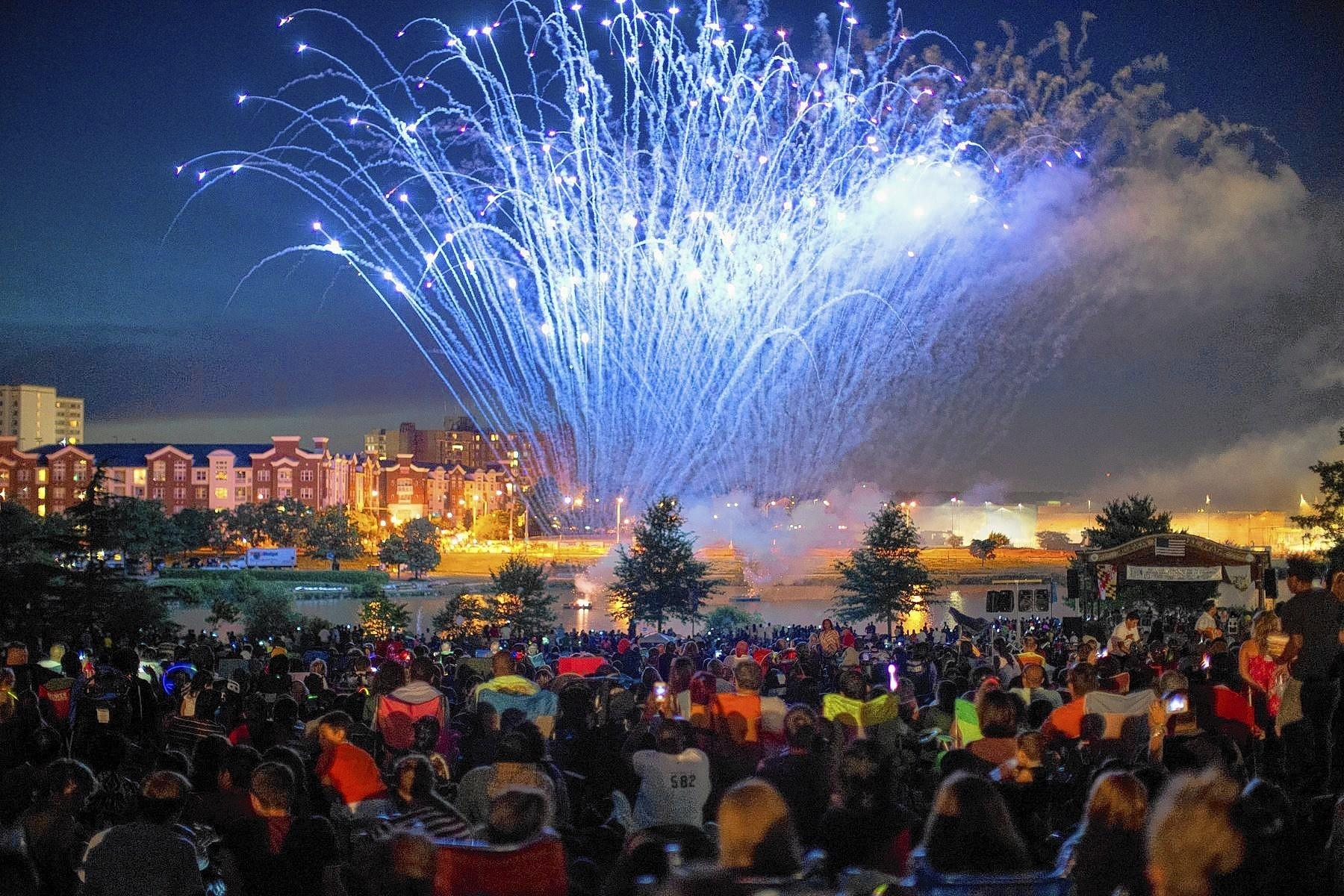 Fireworks light up the neighborhood around Laurel Lakes July 5, which crowds gather to watch at Granville Gude Park.