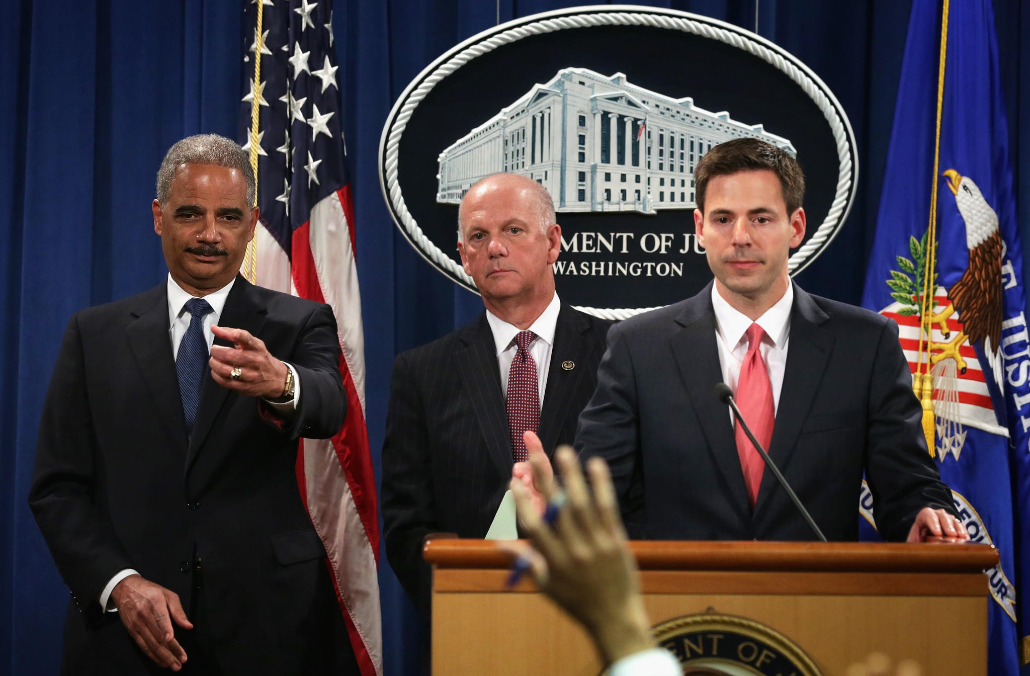 U.S. Attorney General Eric Holder, U.S. Attorney for Western District of Pennsylvania David Hickton, and Assistant Attorney General for National Security John Carlin take questions from members of the media during an announcement on indictments against Chinese military hackers on cyber-espionage May 19, 2014 at the Department of Justice in Washington, DC.
