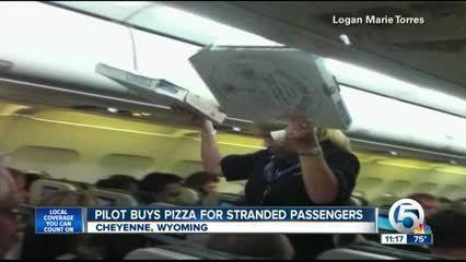 Pilot to pasengers: 'Pizza's on me!' [Video]