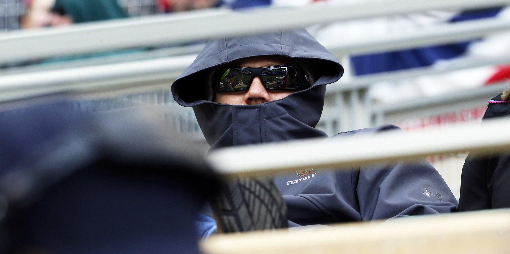 Minnesota Twins fans bundled up against the cold during a game between the Twins and Kansas City Royals.