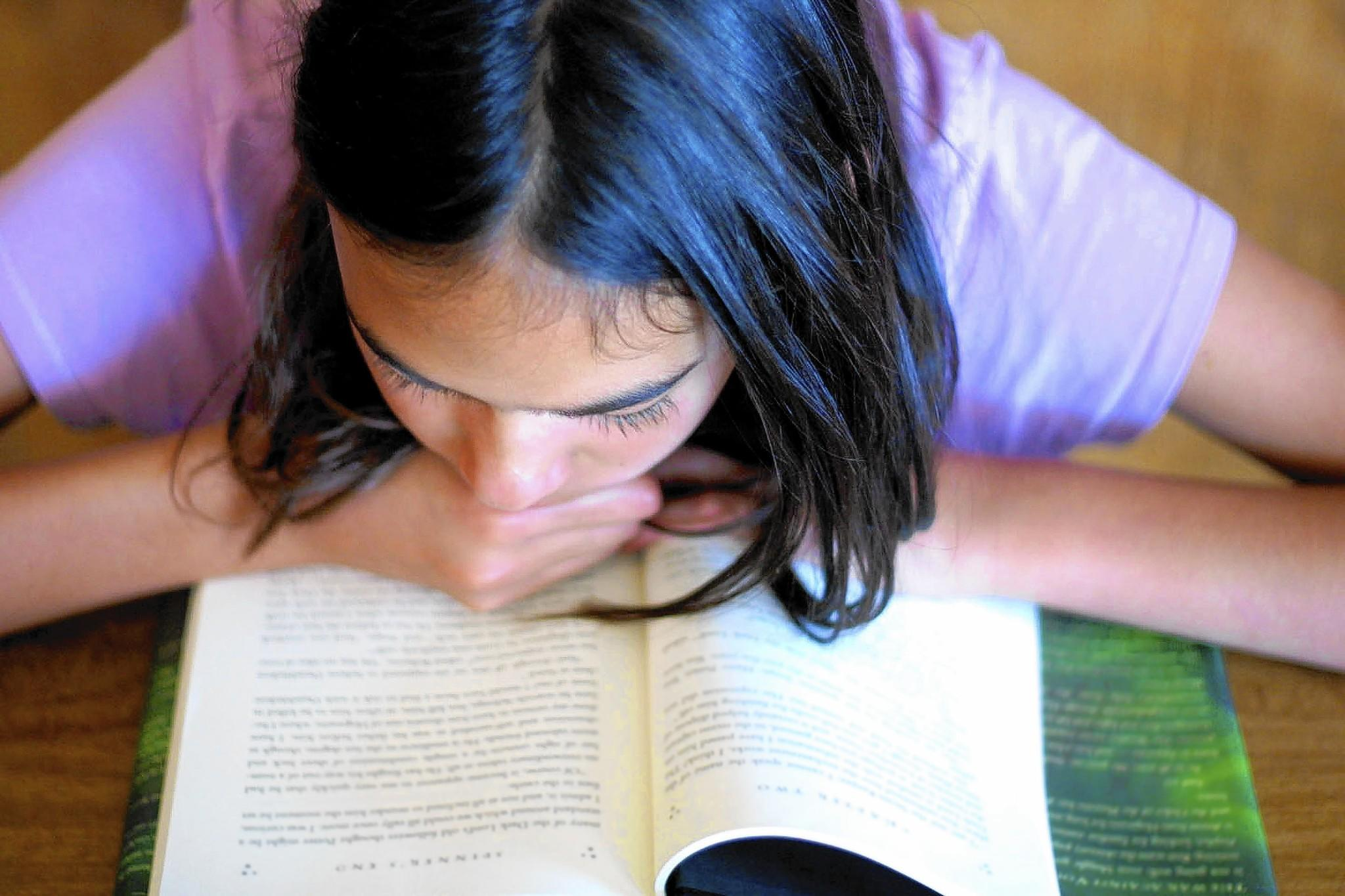 In response to Slate writer Ruth Graham's criticisms of adults reading young adult literature, the Biblioracle argues that you should never be embarrassed about what you read.